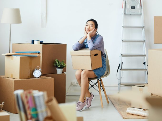 young-asian-woman-waiting-for-moving-crew.jpg